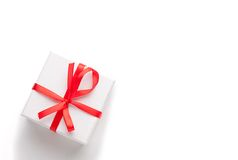 White gift box with red ribbon and bow, isolated Stock Photos