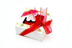 White gift box with red ribbon bow, isolated Royalty Free Stock Photography