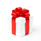White gift box with red ribbon bow Stock Photos