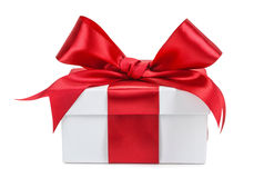 White gift box with red ribbon and bow isolated Royalty Free Stock Image