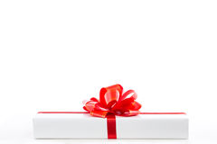 White gift box with red ribbon bow. Stock Image