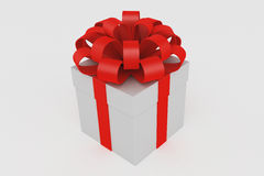 White gift box with red ribbon bow. Royalty Free Stock Photography