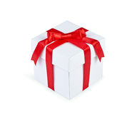 White gift box with red ribbon bow isolated Stock Images
