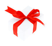 White gift box with red ribbon bow, isolated on white Royalty Free Stock Photography
