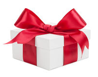 White gift box with red ribbon and bow isolated on a white backg Royalty Free Stock Photo