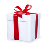 White gift box with red ribbon and bow, isolated on white backgr Royalty Free Stock Photos