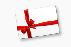 White gift box with red ribbon bow, isolated on white Stock Images