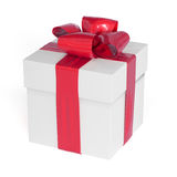 White gift box with red ribbon bow  on white Stock Images