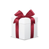 White gift box with red ribbon bow,  on white Royalty Free Stock Photos