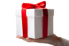 White gift box with red ribbon in hand Royalty Free Stock Image