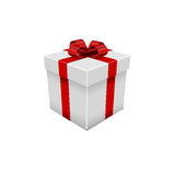 White gift box with red ribbon.  Stock Photos
