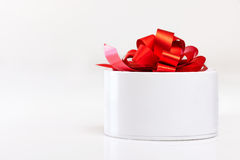 White gift box with red ribbon isolated Royalty Free Stock Images