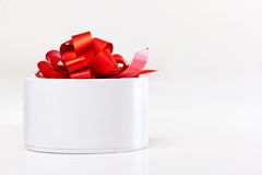 White gift box with red ribbon isolated Royalty Free Stock Photo