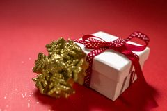 White gift box with red ribbon isolated on red color background. stock images