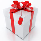 White Gift Box with Red Ribbon on White Background Royalty Free Stock Photography