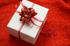 White gift box with red satin ribbon Stock Photo