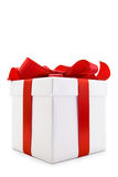 White Gift Box with Red Satin Ribbon Bow Royalty Free Stock Photography