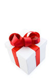 White Gift Box with Red Satin Ribbon Bow Stock Photos