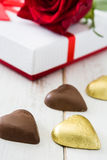 White gift box, roses and chocolate with heart shape Royalty Free Stock Images