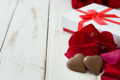 White gift box, roses and chocolate with heart shape Stock Image