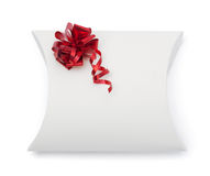 White gift box with scarlet ribbon Royalty Free Stock Photo