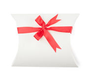 White present box with scarlet ribbon Stock Photo