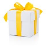 White gift box tied yellow ribbon Isolated on white background Royalty Free Stock Photo