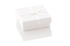 White gift box on a white background Stock Photos