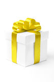 White gift box with yellow ribbon bow Royalty Free Stock Photos