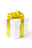 White gift box with yellow ribbon bow Royalty Free Stock Photos