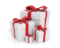 White gift boxes. 3d rendered white gift boxes with red ribbons - Image on white background with soft shadows and reflections Stock Images