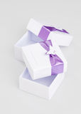 White gift boxes isolated on gradient white Stock Image