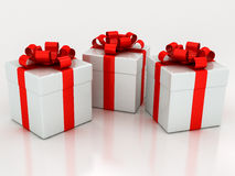 White gift boxes with red ribbon Royalty Free Stock Photos