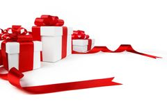 White gift boxes with red ribbon bows. Isolated on white background close-up Stock Photography