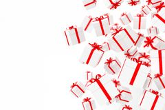 White gift boxes with red ribbon isolated on white background.3d rendering stock images