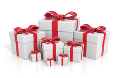White gift boxes with red ribbons Stock Photos