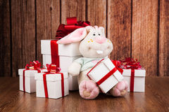 White gift boxes and soft toy on a wood Stock Image