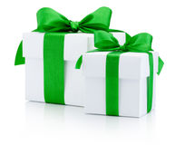 White gift boxes tied green ribbon Isolated on white background Stock Photos