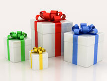 White gift boxes with varicolored ribbon Royalty Free Stock Image