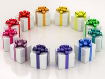 White gift boxes with varicolored ribbon Royalty Free Stock Images