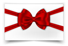 White gift card with red ribbon and bow. Vector illustration Stock Photos