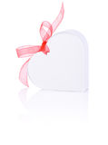 White gift in form of heart with a bow of red ribbon Royalty Free Stock Images