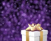 White gift with gold bow Stock Images