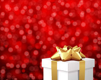 White gift with gold bow Royalty Free Stock Images