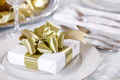 White gift with gold ribbons Stock Images