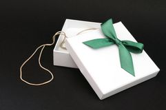 White gift with green ribbon Stock Image