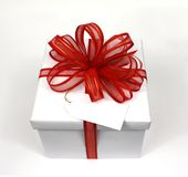 White gift red bow Royalty Free Stock Photo