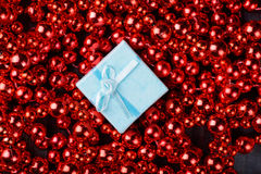 White gift in red garland Royalty Free Stock Images