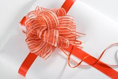 White gift red ribbon stock photo