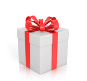 White gift with red ribbon and bow. On a white background Stock Images